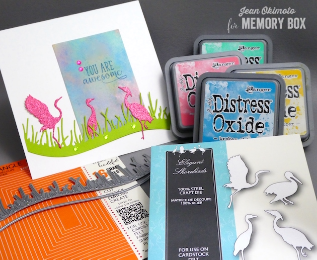 MemoryBoxElegantShorebirds-MemoryBoxPastureGrass-MemoryBoxRectangleBasics-MemoryBoxOpenStudioSpringLilacsClearStampSet-JeanOkimoto-RangerDistressOxides-ImagineCraftsVersaFine-WatercoloredBackgrounds-WatercoloredCards-GlitteredDiecuts