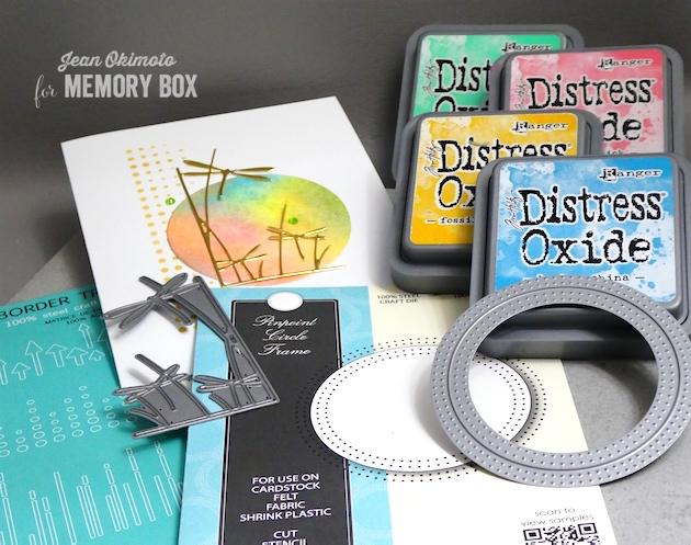 MemoryBoxPinpointCircleFrame-MemoryBoxDragonflyStemsLeftCorner-MemoryBoxModernBorderTrim-JeanOkimoto-DistressOxides-WatercoloredCards-DragonflyCards-WatercoloredDragonflyCards-Delicata-DiecutCards=DragonflyDiecuts