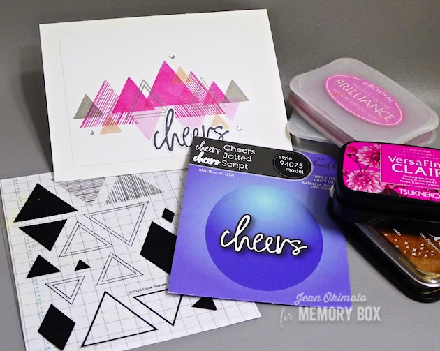 MemoryBoxEqualTriangleClearStampsSet-MemoryBoxCheersJottedScript-MemoryBoxRectangleBasics-JeanOkimoto-ImagineCrafts-VersaFineClair-ImpressCardsAndCrafts-NewYearCards-TriangleCards-DiecutGreetings